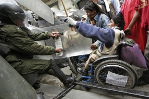 Disabled protestors in Bolivia fighting cops after a 1,000 mile march demanding guaranteed income.