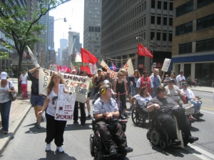 Wheelchair users lead Raise the Rates demo, leaving the rest behind.